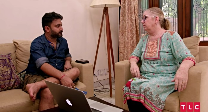 Jenny Slayton and Sumit Singh look worried, talking in their living room at their home in India on '90 Day Fiancé: The Other Way'