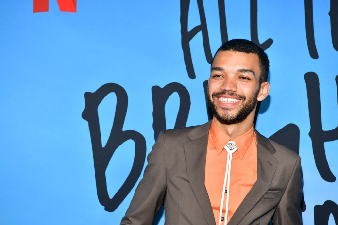 Justice Smith on the red carpet in a suit