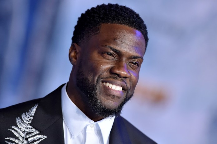 Kevin Hart in a black suit on the red carpet