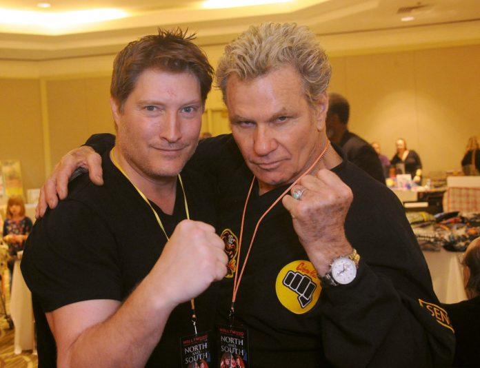 Martin Cove and Sean Kanan pose with their fists