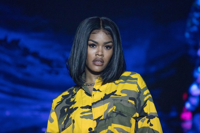 Teyana Taylor on stage performing 'Keep the Promise' at the World AIDS Day concert