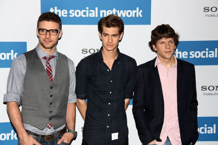 Justin Timberlake, Andrew Garfield, and Jesse Eisenberg attend a photocall to promote the film 'The Social Network' in October 2010.  Garfield played Eduardo Saverin in