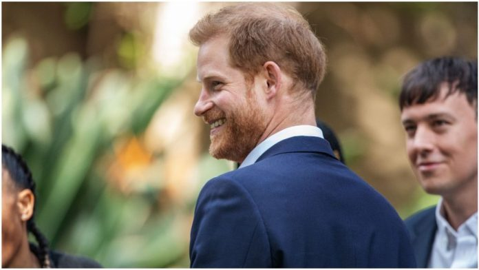 Prince Harry poses for photographers at a royal event.