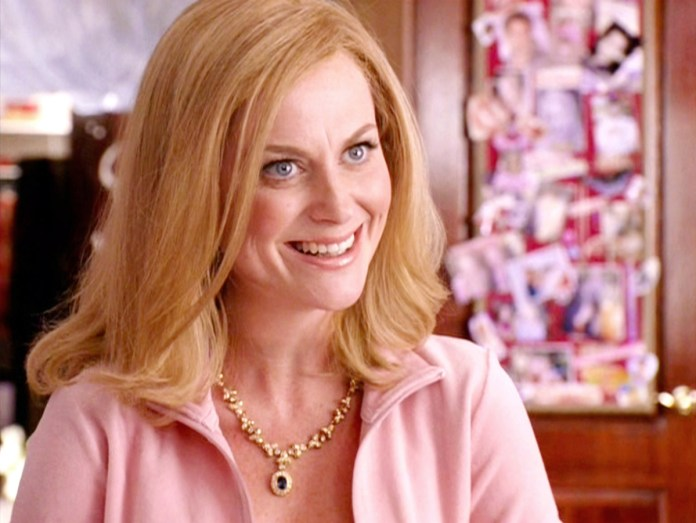 Amy Poehler in a pink tracksuit