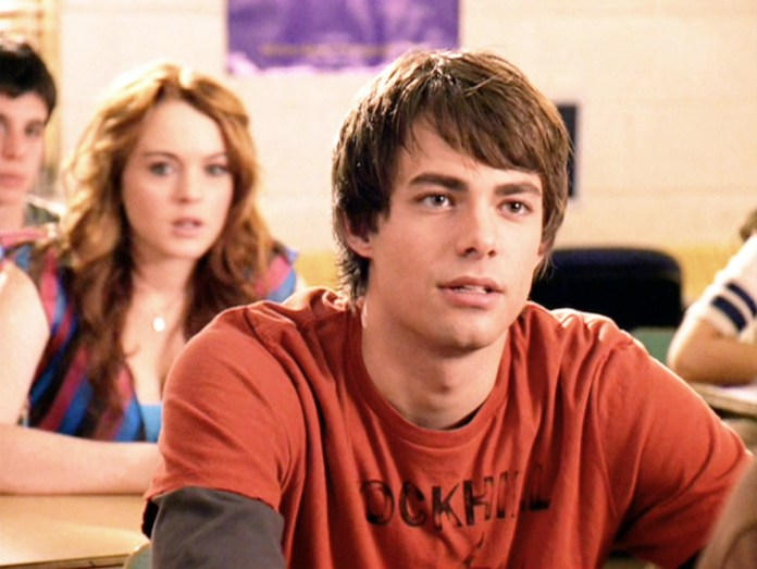 Jonathan Bennett and Lindsay Lohan sit in the classroom during a scene from the movie