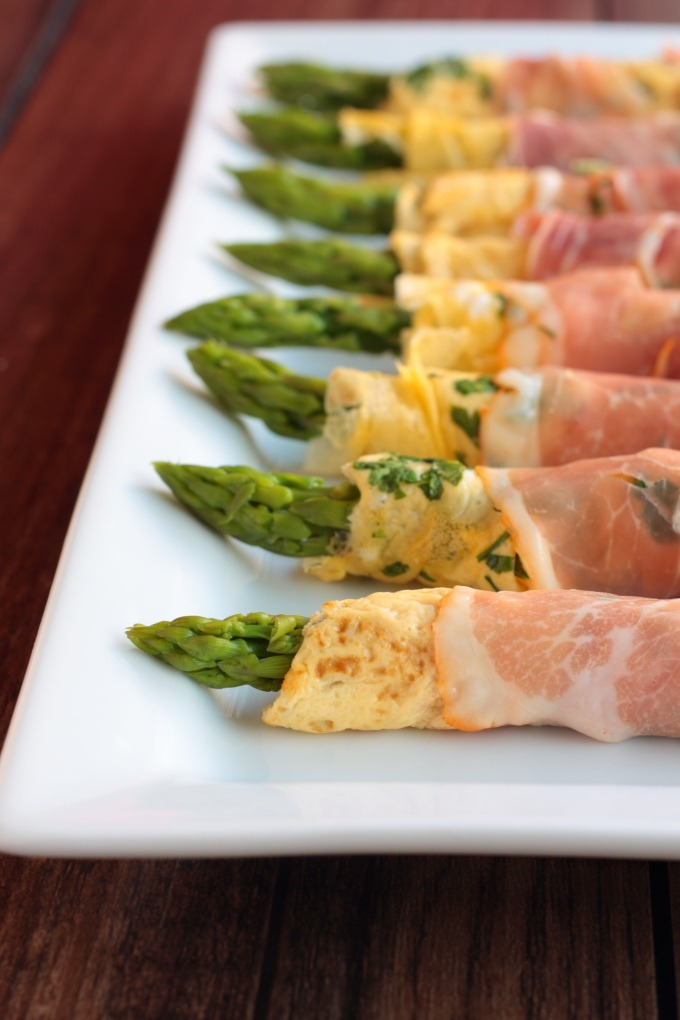 This simple asparagus dish consists of a delicate egg 'crepe' wrapped around asparagus and wrapped again in prosciutto. Lunch, brunch or dinner recipe.