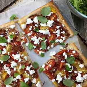Puff Pastry Tomato Tart - transform a sheet of frozen puff pastry in to a spectacular tomato tart, casually strewn with basil & crumbled fetta - and so EASY!