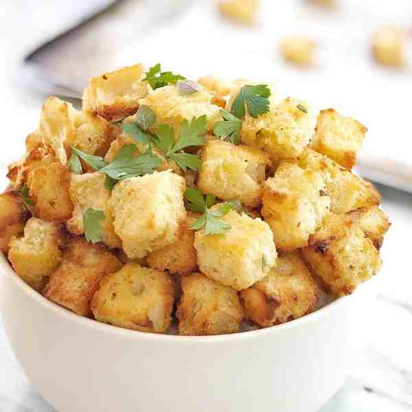 golden cubes of crunchy bread in a white bowl