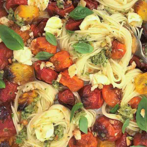 Tomato mozzarella pasta with pesto crumbs - oven roasted cherry tomatoes bocconcini caprese