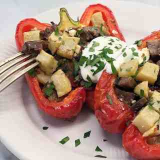 leftover lamb stuffed peppers (capsicums) with potatoes and basil topped with greek yoghurt yogurt