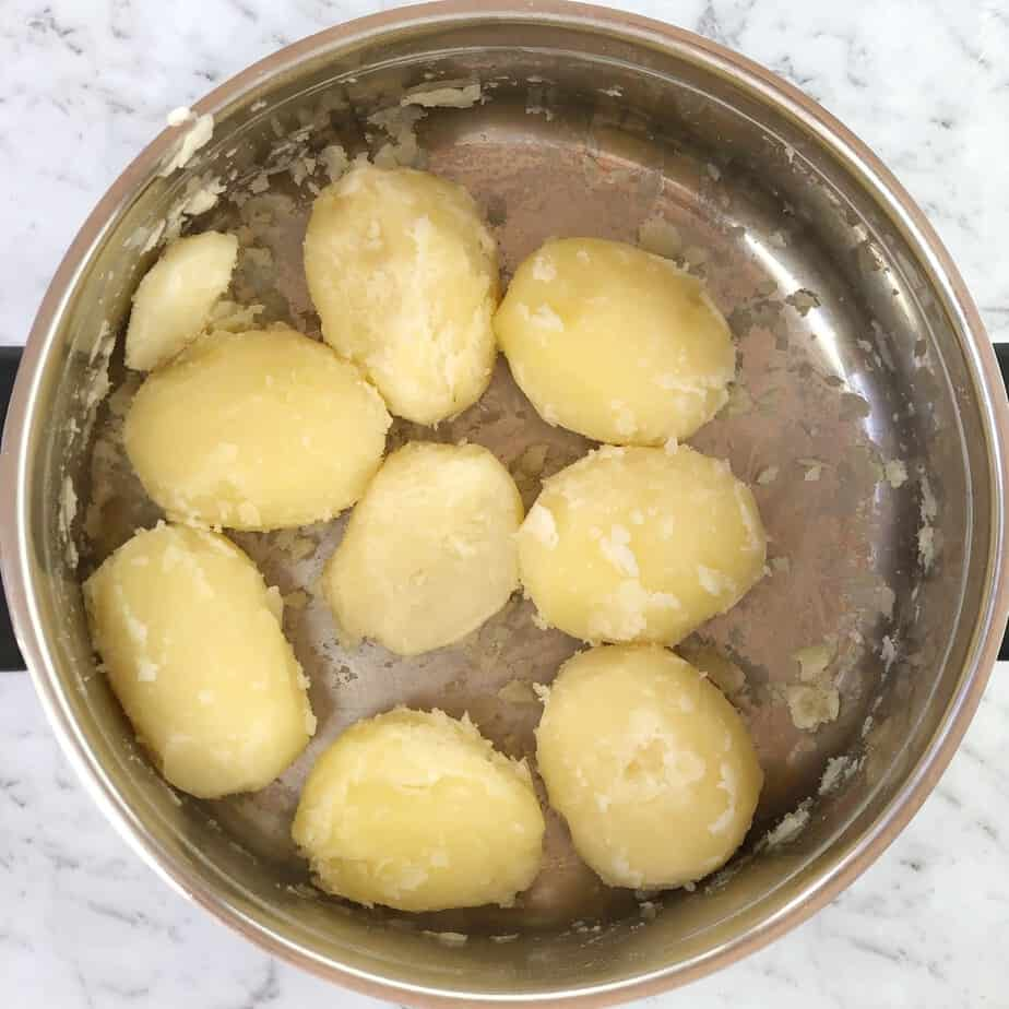 boiled potatoes in steel pot