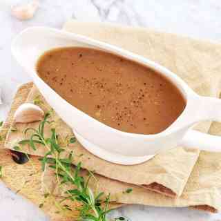 brown gravy in a white gravy boat
