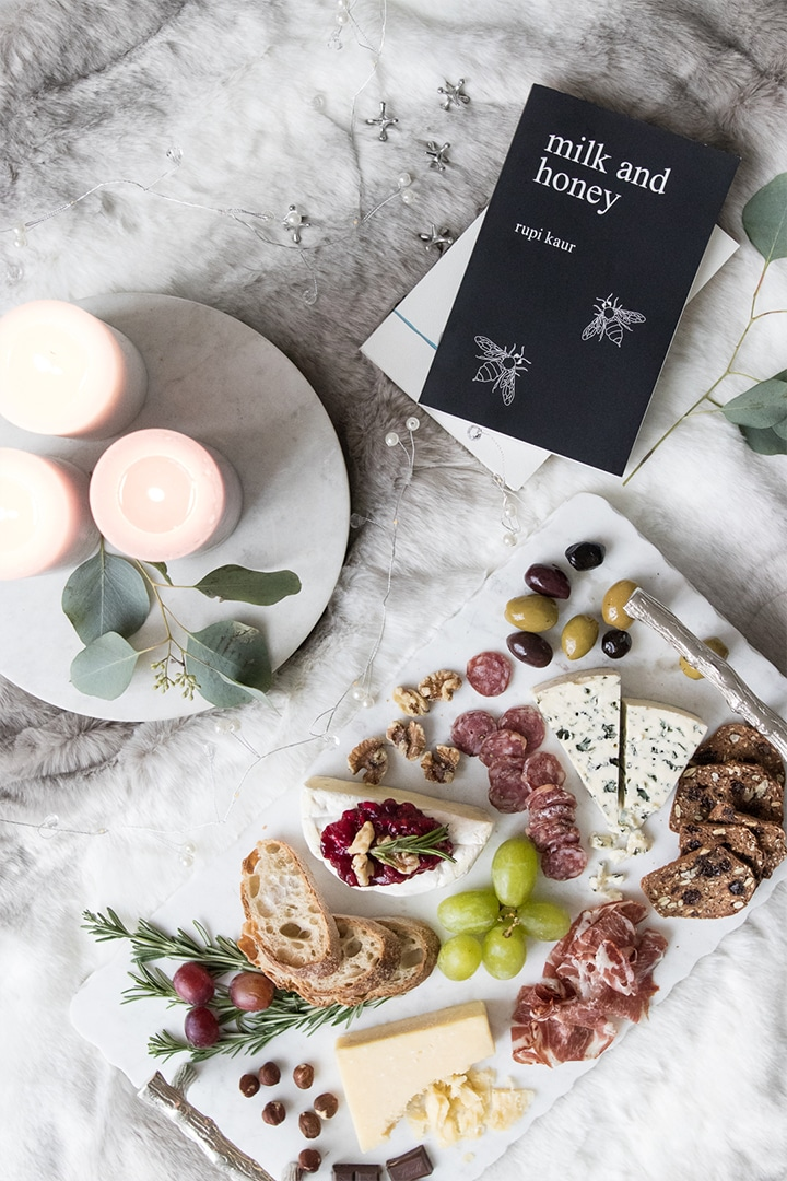 Sometimes you need to take time to yourself during the busy season and there is no better way to do so than with a comforting cheeseboard with Castello Cheese, olives, meat and fruit. #cheeseboard #datenight #charcuterie