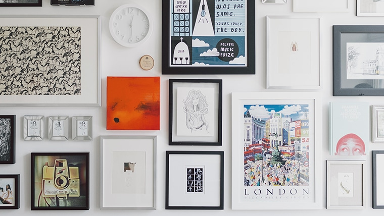Wall of Photos and Art in Frames Arranged in Gallery Style