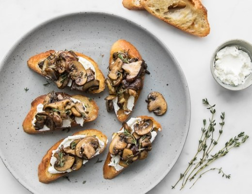 Mushroom Toast on a grey plate with goat cheese and thyme