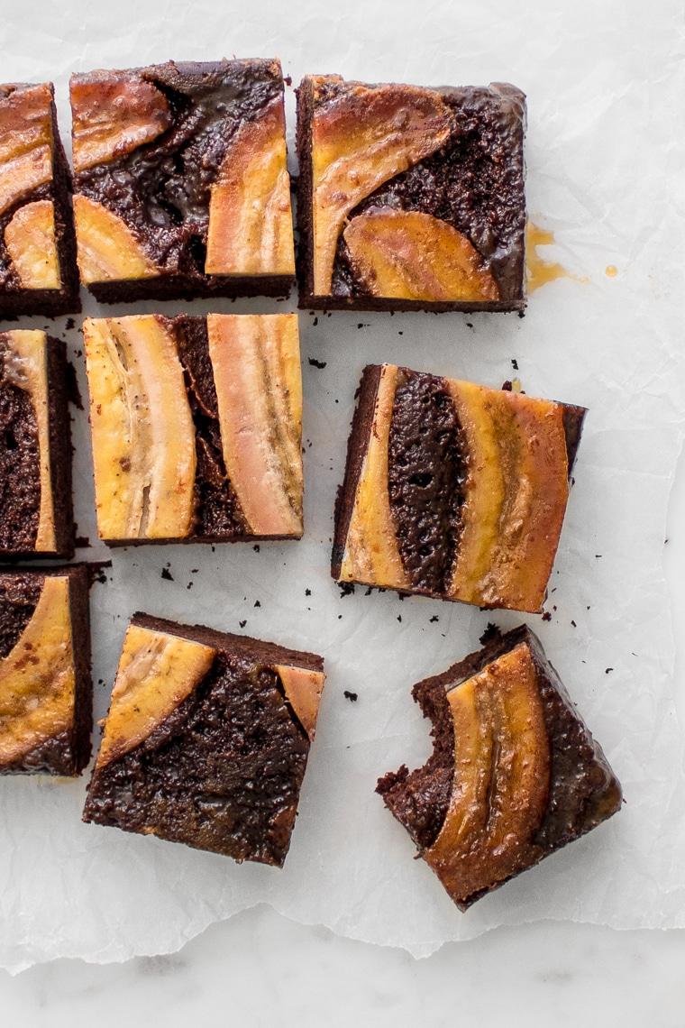 The upside down chocolate banana cake sliced into squares
