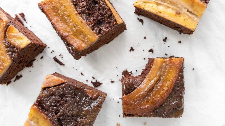 Caramelized Banana Upside Down Cake cut in squares and a bite taken from one