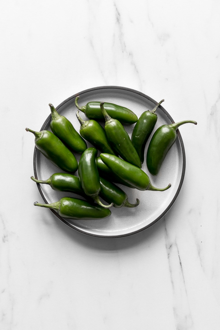 Plate filled with jalapeno peppers