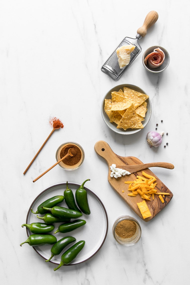Ingredients for roasted jalapeno poppers in flat lay style
