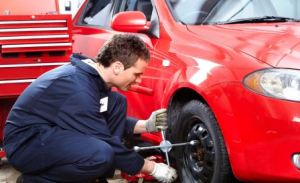 A man fixing the car wheels