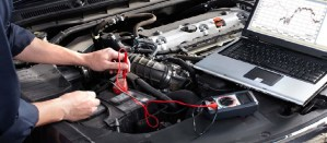 A man checking the car battery