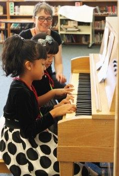 Amy Vanacore, teaching piano