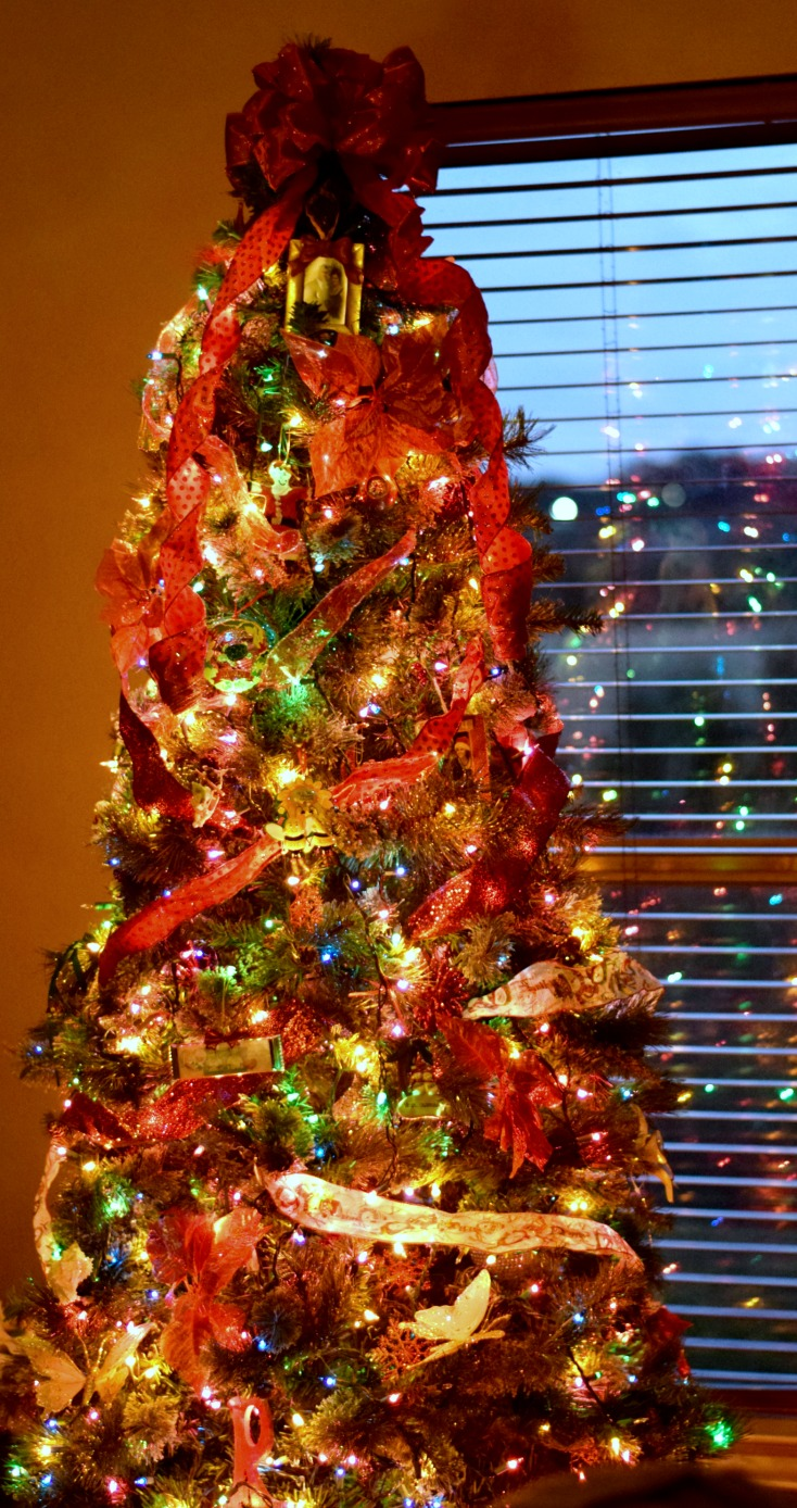 Christmas tree decorating! Use random ribbons to add texture and glam to a smaller tree on chemistrycachet.com