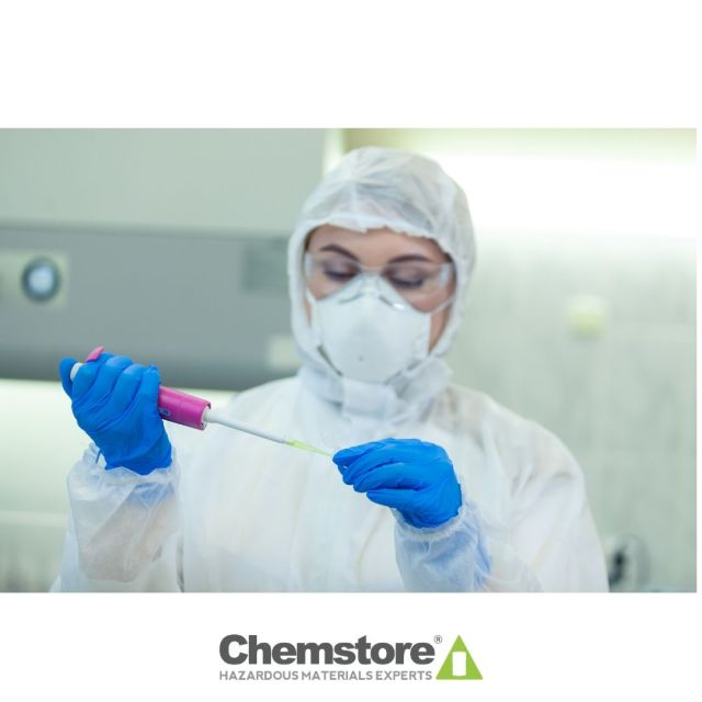 Woman Wearing Protective Coverall In Lab