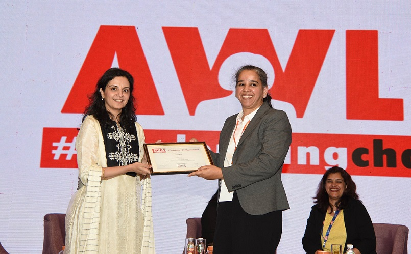 Veena Rao receiving the certificate