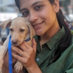 Aditi Balan with a puppy