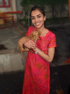 Nishka Choraria with a puppy