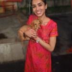 Nishka Choraria with a puppy