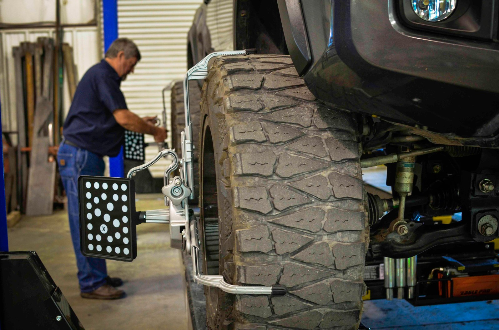 Clifford sets up a vehicle on our new alignment machine.