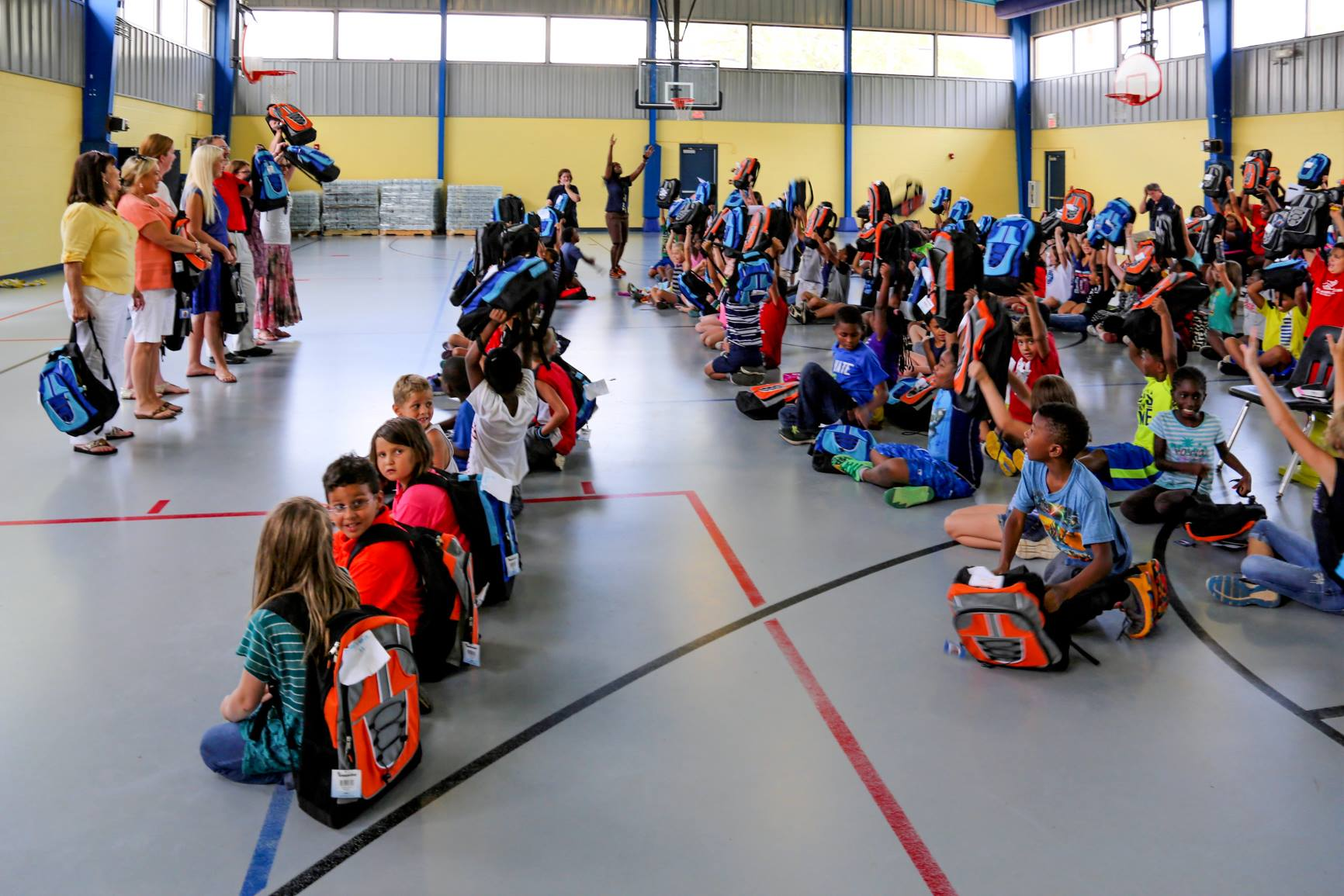 Cherokee Association Donates Backpacks To Local Boys & Girls Club