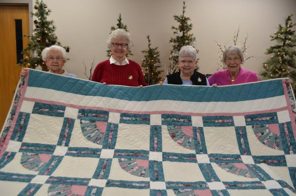 Women with Quilt