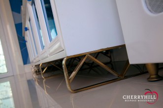 Custom television stand in the informal lounge of a private Sandhurst residence.