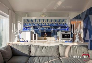 Custom bar unit in the informal lounge of a private Sandhurst residence.