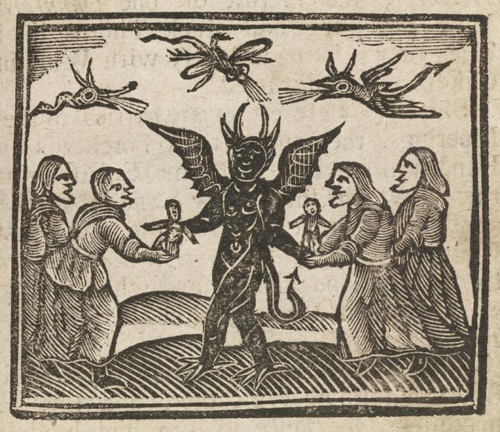 In this medieval woodcut, witches present wax dolls to Satan.