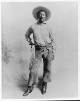 Bill Pickett, a Black cowboy, in cowboy gear.