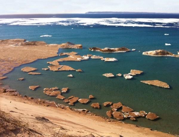 Sand-covered ice in Sleeping Bear Bay