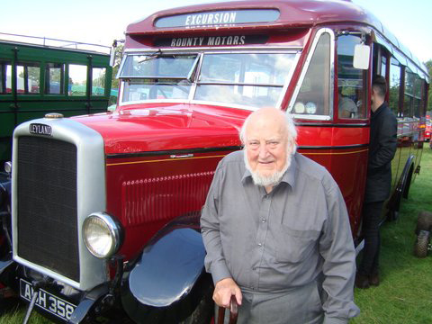 Gerald alongside one of his vintage coaches