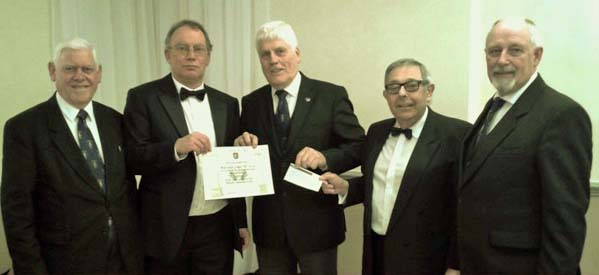 Left to Right – W.Brothers: -Brian Mayoh (Prov Assistant Grand Secretary) Representative of the RWPGM, David Stratton-Powell WM, Colin Ross Provincial Grand Charity Steward, Jack Weiner Lodge Charity Steward, Keith Gray Area Charity Steward.