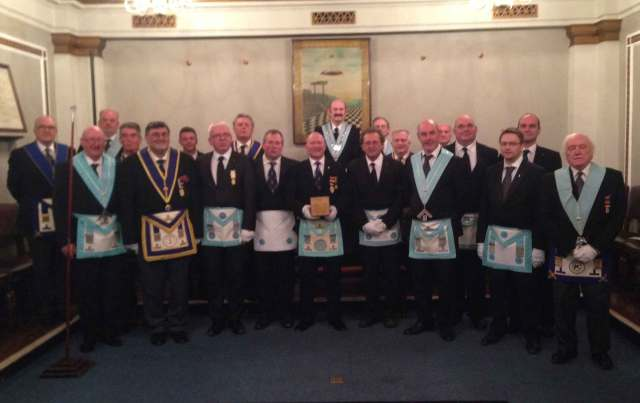 members-of-Prudence-Lodge-4127-and-St.-Nicholas-Lodge-4060-handing-over-the-trophy
