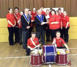 WBro Barry Kirby and WBro Robert Burler presenting the cheques to Wirral Band
