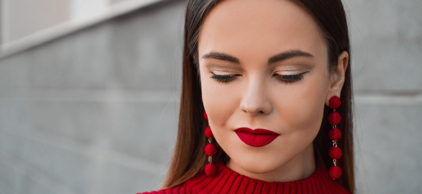 women with red lipstick red jumper