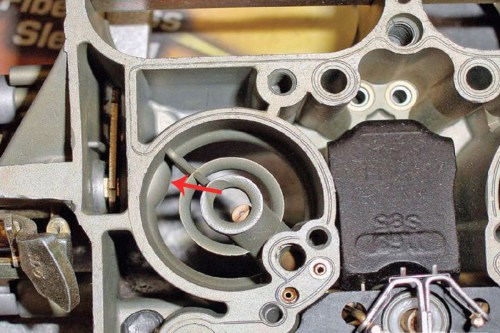 small resolution of the carburetor on the left has the bulge arrow and is an 800 cfm unit the one on the right does not have the bulge which makes it a 750 cfm unit