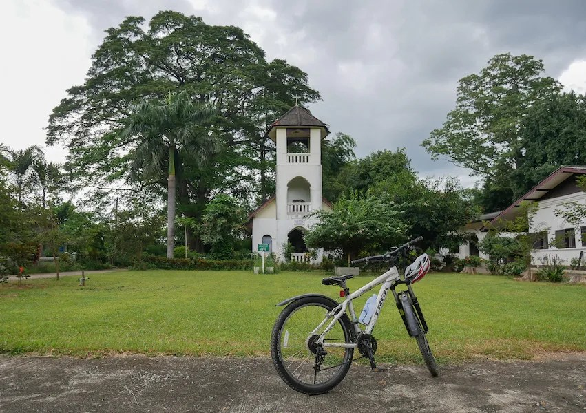 Old church with bicycle parked in front