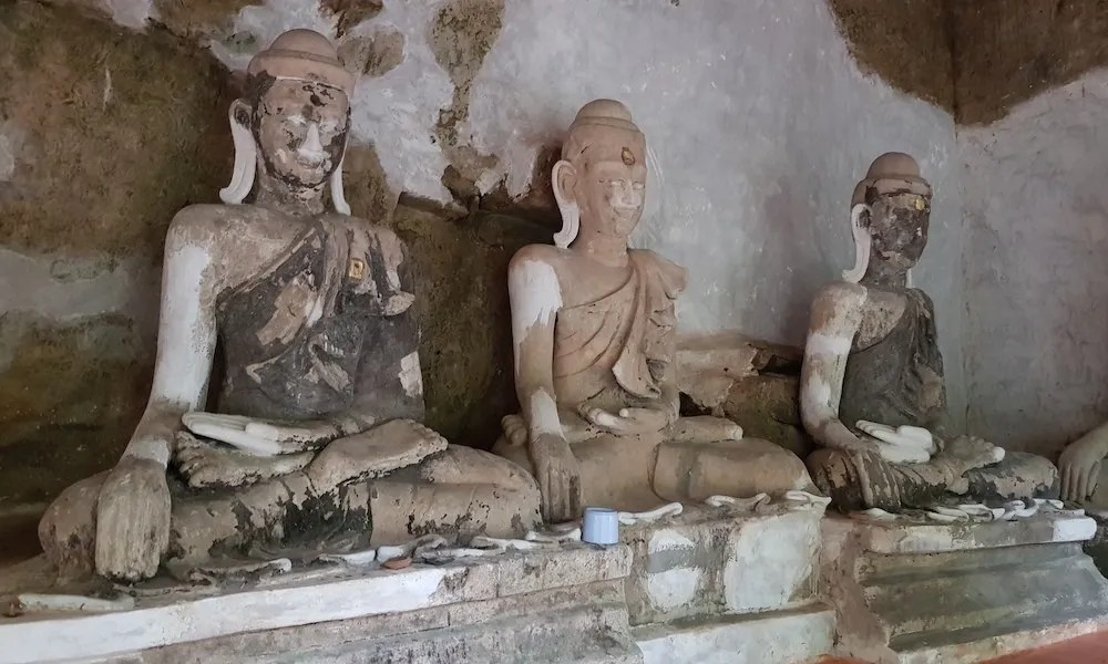 Old Buddha statues in a cave Wat Pha Lat