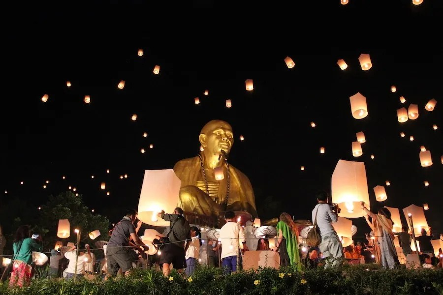 Monk statue with sky lanterns