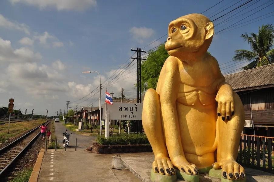 Golden monkey statue at trainstation Thailand Railway Journeys